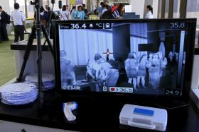 A monitor connected to a body temperature scanner at Ninoy Aquino International Airport in Manila. MOH sought  assured the public that there was no cause for alarme despite reports saying that a Finnish man who traveled through Singapore was recently diagnosed with Mers-CoV