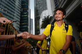 HUMBLE HUMMELS: Borussia Dortmund captain Mats Hummels shaking hands with fans outside the Fullerton Hotel yesterday.