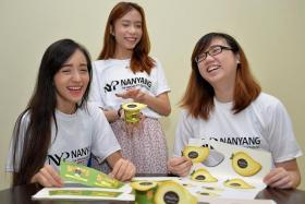 MANGO DELIGHT: Nanyang Polyechnic students (from left) Janessa Tan, Goh Si Min and Tong Lin were part of a team that created mango dessert Mangolina.