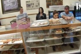 Pop star Ariana Grande (second from right) was caught on video licking a donut and leaving it there for someone else to buy it.