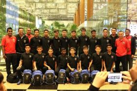 GOTHENBURG BOUND: The Under-13 players with (standing, from far left) F-17 Academy general manager Muhd Shamir and football director Fandi Ahmad.