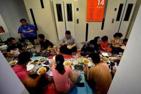 MAKAN: The residents of the 14th floor of Block 591A Montreal Link, share a meal during the breaking of the fast.