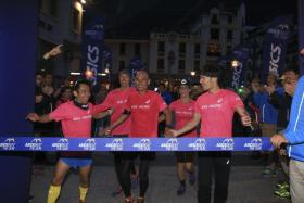 Team Asia Pacific crossing the finish line together. (First row from left) Mr Andy Neo, Mr Winston Ng, Mr Shingo Shintani. (Second row from left) Mr Pete Jacobs and Mrs Jamielle Jacobs. Mr Kota Araki is at the back in the blue jacket.