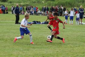 ATTACKING FORAY: (From right, in red) F-17 Under-11 forward Aryan Bahadur Chetri and Russell Tan attacking IFK Stocksund at the Gothia Cup.