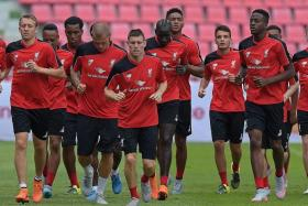 GETTING INTO STRIDE: Liverpool are hoping their players, including new signing James Milner (above, centre, training with the team in Bangkok) make a strong start to the Premier League season.
