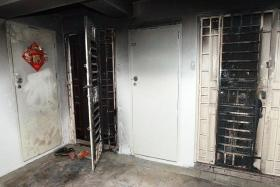 CRIME: Loan sharks are believed to have set fire to the front of these flats. Even instructing someone to commit an offence will make a person liable under the new Bill.