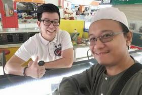 Facebook user Fais Al-Hajari's (right) post on his friendship with a cellphone seller at Low Yat Plaza has gone viral.
