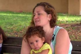 Screen grab of Ms Sarah Robinson with one of her six children.