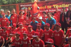 FOR A GOOD CAUSE: The Liverpool academy coaches at the Bangkok School for the Blind (above), together with Reds legend Ian Rush.