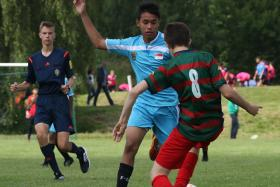 SOLID SHIFT: F-17 U-13 captain Zamani Zamri (in blue) led by example, after a commanding display against England's Heath & Regents Park.