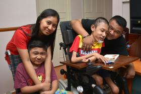 STAYING STRONG: (Above, from far left) Madam Rosidah Omar, with her sons Muhd Danial, 10 and Mohd Sufyan, 15, and her husband Sohaimi Wari. An old photograph of the boys when they could still walk.