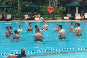Arsenal players indulge in a game of keepy uppy in the Shangri-La Hotel pool.