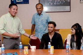ALL SMILES: Law Minister K. Shanmugam (in blue) with Mr Muhammed Hanafie and his girlfriend, Miss Nabilah Nasser, met over iftar yesterday.