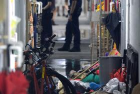 AT THE SCENE: The cluttered corridor outside Mr Tan's flat.