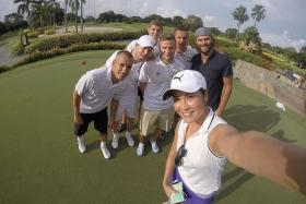 STARS GALORE: Singapore golfer Heng Su-Ann snapping a wefie with (from left) Everton stars Leon Osman, Steven Naismith, John Stones, Tom Cleverley, Phil Jagielka and Liverpool legend Patrik Berger at Tanah Merah Country Club.