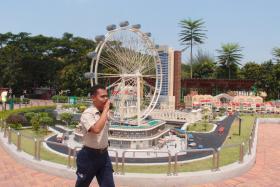 Park ranger Norirwan Abdul Kadir patrolling the Legoland theme park in Johor, Malaysia.