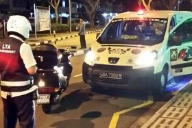 OVERLY STRICT ENFORCEMENT? A Land Transport Authority officer issuing a summons to Mr Mohammed Faizal Mahmud's vehicle. It was quashed on appeal. The incident has gone viral after Mr Faizal posted it online.