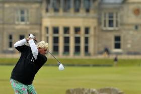 COLOURFUL: American golfer John Daly (left), wearing garish pink and green pants, teeing off from the 18th tee during the first round on Thursday.