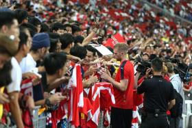 GOOD TURNOUT: The huge welcome by fans for the Barclays Asia Trophy players like Per Mertesacker (near left) is a plus point in the Premier League's assessment of the tournament returning to Singapore.