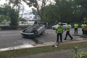 FATAL: (Above) The silver Mercedes Benz which overturned on Bukit Timah Road.