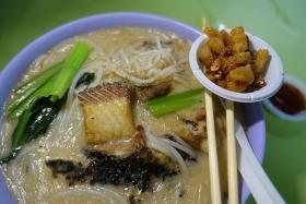 DELICIOUS: Fish head soup noodle.