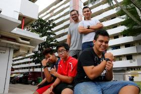 BUDDING PHOTOGRAPHERS: (Front row, from left) Firdaus Hakim Rasdi, 16, Danny Azrin Abdullah, 15, and Arash Mohammad Yasin, 17, took part in the In The Interim photography project. They were led by (back row, from left) Mr Khamsya Khidzer, 29, and Mr Shamil Zainuddin, 31, from volunteer group Kopitiam Lengkok Bahru.
