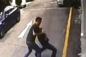 VIOLENT: Automobile sales executive Louis Zhan's neck was caught in an armlock by the owner of a neighbouring company.