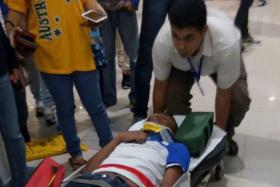 An injured teen taken to the hospital after a brawl broke out at a Kuala Lumpur mall.