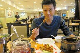Local actor Andie Chen having lunch at A-One Claypot House at Suntec City Mall.