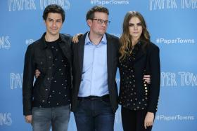Author John Green (C) and Cast Members Nat Wolff (L) and Cara Delevingne at a photo call promoting their film Paper Towns at Claridges in London
