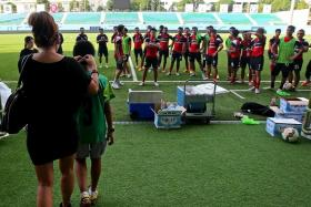 DREAM COME TRUE: A blindfolded Abang walks onto the Jalan Besar Stadium pitch unaware that his idols - the LionsXII - are waiting to greet him.