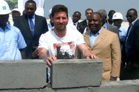 Lionel Messi laying the first stone at the construction site of a new soccer stadium in Port-Gentil, Gabon, on July 18