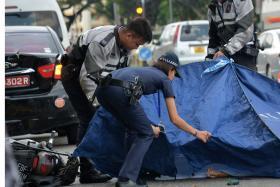 TRAGIC: Paramedics pronounced Mr Wong Sang Him dead at the scene of the accident at Yishun Avenue 2.