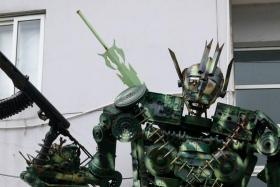 The Chinese People's Liberation Army has built a four-metre tall robot sculpture out of spare parts.
