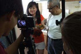 RECIPE FOR FRIENDSHIP: Neighbours Rachel Hoon (left) and Mr Mahmood Maricar being filmed by the My Singapore Food team.