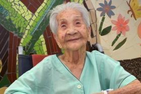 Madam Choon Keng Chan, 101, who fell in her living room and received help from the EMS
