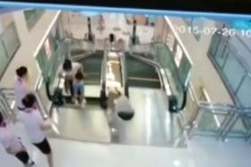 A woman was killed after she plunged through the flooring over an escalator in a Chinese department store.