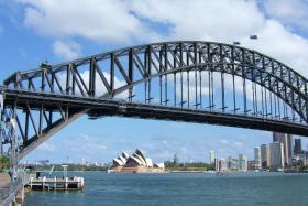 Take advantage of falling Australian dollar and book a vacation down under, advises economist.