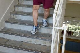 DIFFICULTIES: After taking the new drug Ceritinib, Mr Lim can now climb stairs (above) and does not feel any breathing difficulty.