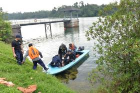 SEARCH: SCDF officers, including the Dart team, searched three areas of MacRitchie Reservoir for a missing woman.