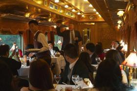 DINNER TIME: Jonathan Phang telling passengers about his menu