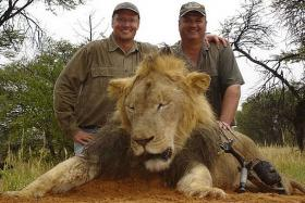 Walter Palmer (left) is allegedly responsible for killing one of Zimbabwe's most beloved and oldest lions.