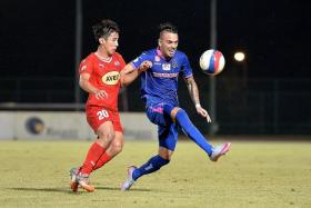 """I'm very happy to have this chance, but I'm sad to leave Warriors, because I am leaving behind many friends in Singapore."" - Warriors' Nicolas Velez (in blue, fending off Home's Ang Zhi Wei in last night's match)"