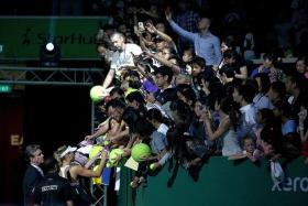 FANFARE: Maria Sharapova obliging autograph hunters at last year's WTA FInals at the Sports Hub.
