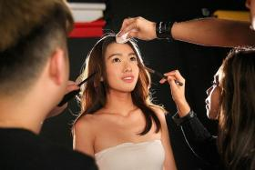 ONE LAST THING: Denise Pung gets a final touch-up just before her photo shoot.