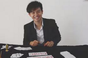 Undergraduate Sng Ming Da, 24, used magic to pay tribute to Singapore turning 50.