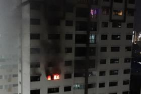 BURNED: Residents living on the 12th, 13th and 14th storeys of Block 688A, Choa Chu Kang Drive, were evacuated after the 45-year-old man set fire to his 12th storey unit. The man was later arrested for mischief by fire.