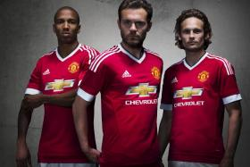 Ashley Young, Juan Mata and Daley Blind model Manchester United's new Adidas kit.