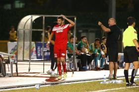 ANGRY TIGERS: Balestier's Miroslav Kristic (in red) walking off after being controversially sent off, leaving his coach Marko Kraljevic (in black) fuming.