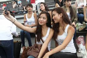 SISTERS: Amy Syireen Marican (holding camera) and Stacey Manoharan posing for a wefie.